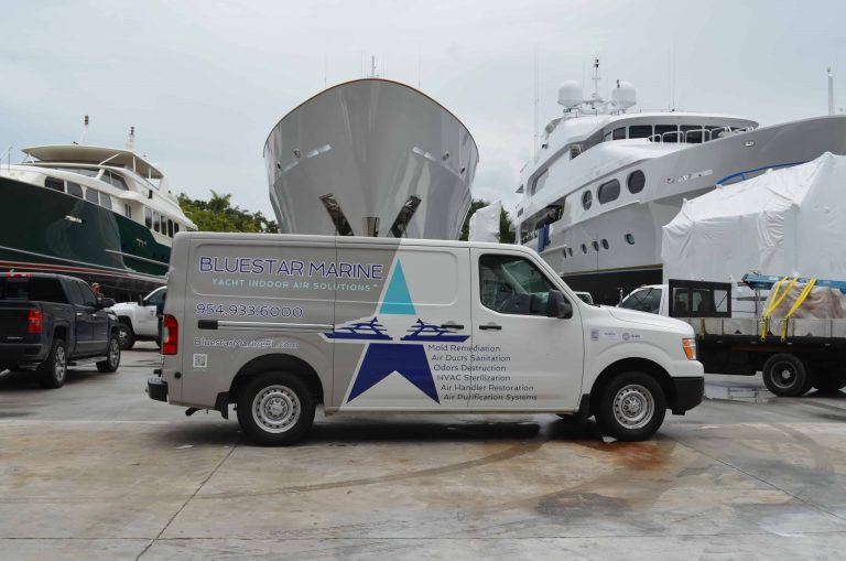 Bluestar Marine van in front of yachts. Mold remediation.