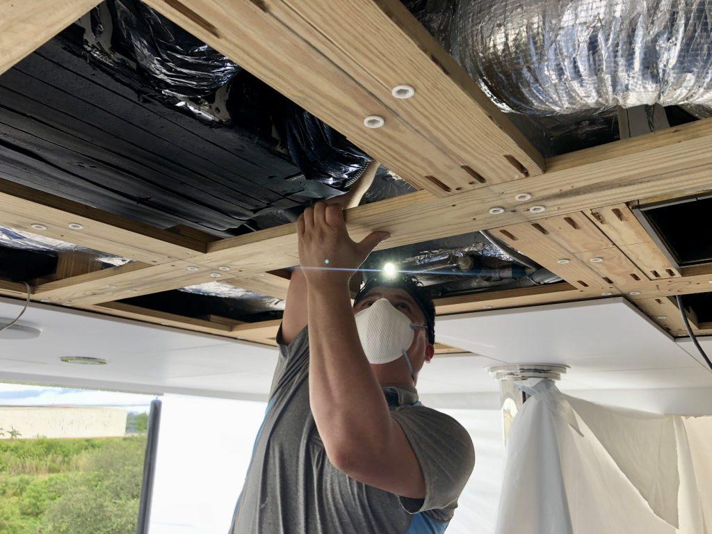 Bluestar Marine technician cleaning marine air duct