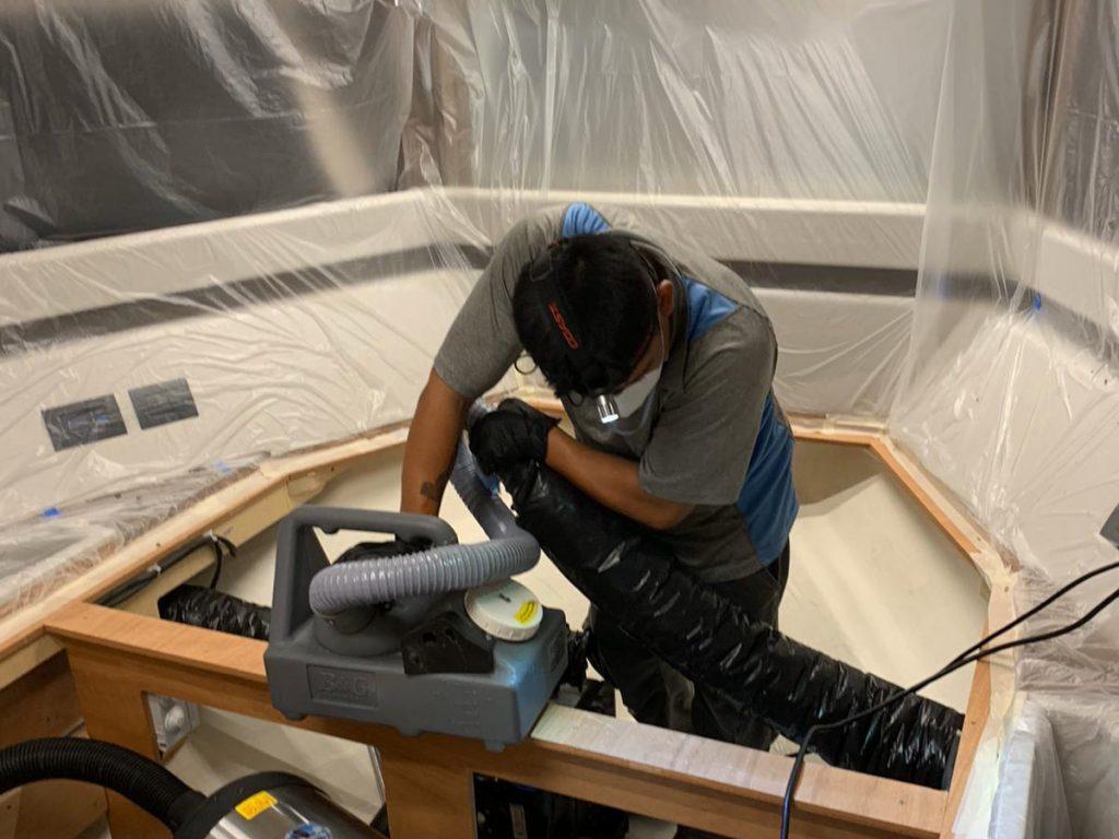 Bluestar Marine technician cleaning yacht air duct
